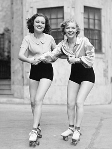 vintage-black-and-white-young-women-roller-skating-friends